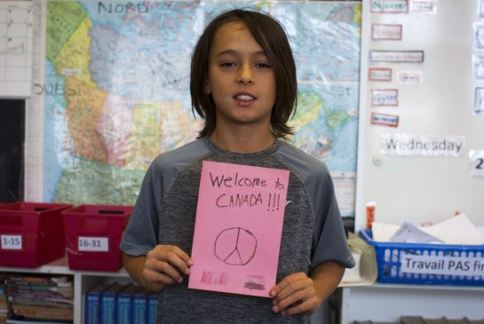 Kids welcome Syrian refugees with messages 'from the heart'